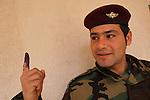 ERBIL, IRAQ: A Kurdish Peshmerga soldier votes in the Ahmedi Khani school in Erbil...Three days before the polls open, military and convicts vote in the Iraqi Parliamentary Elections...Photo by Rafiq Tekin/Metrography
