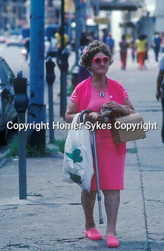 Coney Island New Jersey USA Circa 1970. Senior woman in red frame sun glasses.