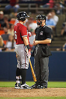 Carolina Mudcats Joseph Odom (6) talks with umpire Chris Marco after an at bat during a game against the Frederick Keys on June 4, 2016 at Nymeo Field at Harry Grove Stadium in Frederick, Maryland.  Frederick defeated Carolina 5-4 in eleven innings.  (Mike Janes/Four Seam Images)