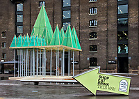 King's Cross, London's newest creative neighbourhood, launched its 'traditionally untraditional' Christmas. King's Cross has become known for its unconventional take on Christmas, and 2020 is just as extraordinary.<br /> Set throughout the King's Cross neighbourhood are three iconic Christmas trees, each delivering an alternative, unexpected interpretation of the traditional festive tree. Granary Square plays host to the Electric Nemeton Tree, designed by local architecture practice Sam Jacob Studio.In Coal Drops Yard sits the Terrarium Tree, a sustainable creation comprised of 70 living Botanical Boys terrariums and in Battle Bridge Place is the People's Tree, an interactive multi-coloured installation illuminated by the steps and sensory movements of visitors. Kings Cross, London. November 25th 2020<br /> <br /> Photo by Keith Mayhew