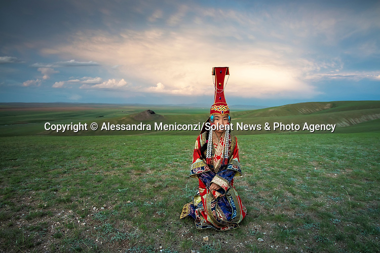 """Pictured: The spectacular traditional clothes of Mongolian Nomads are showcased in a series of beguiling portrait shots.   These brightly coloured and bejewelled garments are handed down through generations.<br /> <br /> Freelance photographer Alessandra Meniconzi travelled from her home in Lugano, Switzerland, to Central Mongolia to set up the shoot.   Ms Meniconzi said: """"In the past the kings and queens and royalty of the Mongolian nomads used to wear these traditional clothes which are decorated with the beautiful jewels.  SEE OUR COPY FOR DETAILS<br /> <br /> Please byline: Alessandra Meniconzi/Solent News<br /> <br /> © Alessandra Meniconzi/Solent News & Photo Agency<br /> UK +44 (0) 2380 458800"""