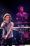 Former INXS vocalist, Michael Hutchence, performs during one of the band's concerts.  Hutchence committed suicide leaving the Australian band without a vocalist until recently.