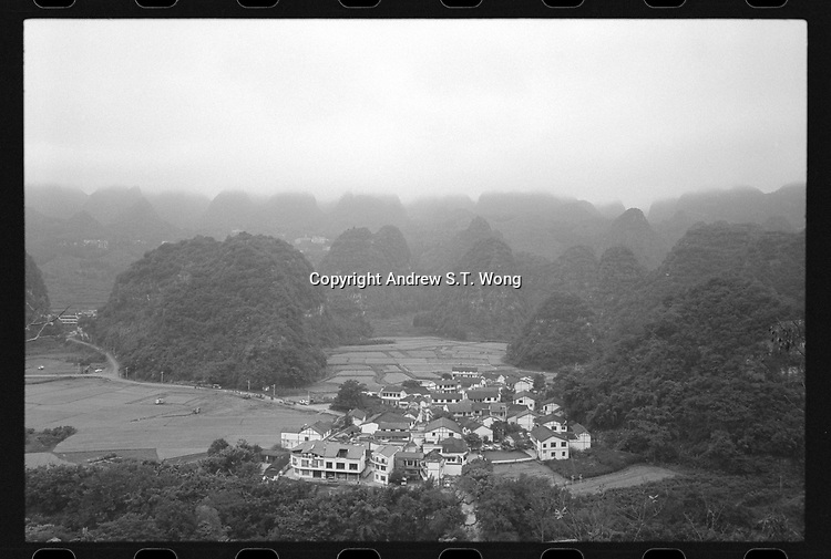 A village at Wanfengli, Xingyi, Guizhou Province, 2018.