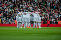 LONDON, ENGLAND - MAY 11 Swansea team huddle prior to the Premier League match between Arsenal and Swansea City at Emirates Stadium on May 11, 2015 in London, England.  (Photo by Athena Pictures/Getty Images)