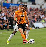 11th September 2021; Swansea.com Stadium, Swansea, Wales; EFL Championship football, Swansea versus Hull City; Greg Docherty of Hull City passes the ball while under pressure from Ethan Laird of Swansea City