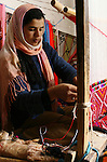 Berber woman weaving a carpet in the village of Toujane. Toujane is a Berber mountainous village in southern Tunisia, near Medenine, divided in two parts by a valley.
