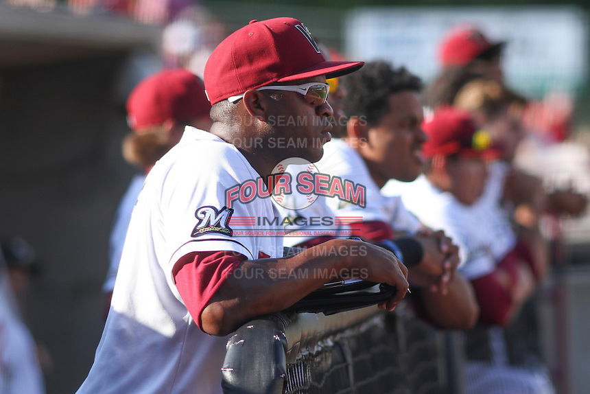 Wisconsin Timber Rattlers coach Chuckie Caufield (4) looks on from the dugout during a Midwest League game against the Quad Cities River Bandits on July 17th, 2015 at Fox Cities Stadium in Appleton, Wisconsin. Quad Cities defeated Wisconsin 4-2. (Brad Krause/Four Seam Images)