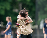NEWTON, MA - MAY 22: Charlotte North #8 of Boston College celebrates victory with her teammates after NCAA Division I Women's Lacrosse Tournament quarterfinal round game between Notre Dame and Boston College at Newton Campus Lacrosse Field on May 22, 2021 in Newton, Massachusetts.