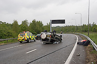 Road traffic accident involving a Mitsubishi Pajero four wheel drive vehicle that as rolled onto its roof Warwickshire UK. This image may only be used to portray the subject in a positive manner..©shoutpictures.com..john@shoutpictures.com