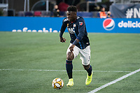 FOXBOROUGH, MA - SEPTEMBER 29: Jalil Anibaba #3 of New England Revolution brings the ball forward during a game between New York City FC and New England Revolution at Gillettes Stadium on September 29, 2019 in Foxborough, Massachusetts.