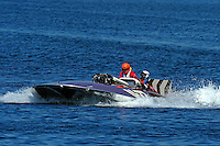 """Original driver Mira Slovak (white helmet) and driver David Williams in the U-77 """"Miss Wahoo"""" (Replica of the vintage 1956 hull built in 2009) bring the boat back to dock...1-2 August, 2009 Seattle, Washington USA..©2009 F.Peirce Williams USA.."""