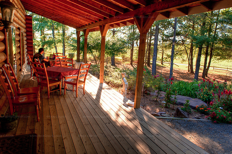 The front porch of Hidden Brook Winery offers a spacious, quiet, shaded place to sit with a glass of wine.  And maybe a computer. (HDR Image)