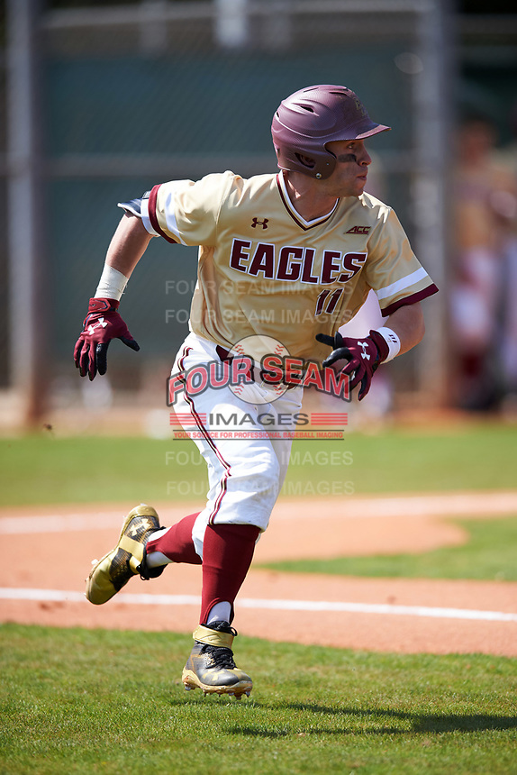 Boston College Eagles second baseman Jake Palomaki (11) runs to first base during a game against the Central Michigan Chippewas on March 3, 2017 at North Charlotte Regional Park in Port Charlotte, Florida.  Boston College defeated Central Michigan 5-4.  (Mike Janes/Four Seam Images)