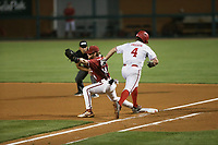Arkansas infielder Cullen Smith (14) forces out Nebraska infielder Max Anderson (4), Saturday, June 5, 2021 in the second game of the NCAA Fayetteville Regional at Baum-Walker Stadium in Fayetteville. Check out nwaonline.com/210606Daily/ for today's photo gallery. <br /> (NWA Democrat-Gazette/Charlie Kaijo)