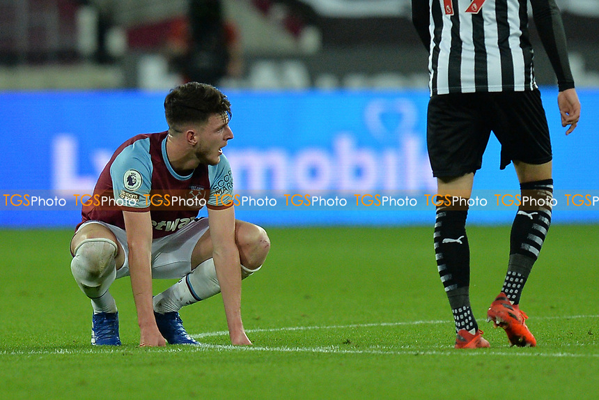 Declan Rice of West Ham United goes down injured  during West Ham United vs Newcastle United, Premier League Football at The London Stadium on 12th September 2020