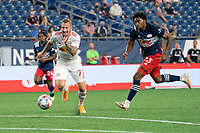 FOXBOROUGH, MA - MAY 22: Daniel Royer #77 of New York Red Bulls advances on the New England Revolution goal during a game between New York Red Bulls and New England Revolution at Gillette Stadium on May 22, 2021 in Foxborough, Massachusetts.