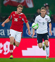 VIENNA, Austria - November 19, 2013: Aron Johannsson and Austria's Martin Hinteregger during a 0-1 loss to host Austria during the international friendly match between Austria and the USA at Ernst-Happel-Stadium.