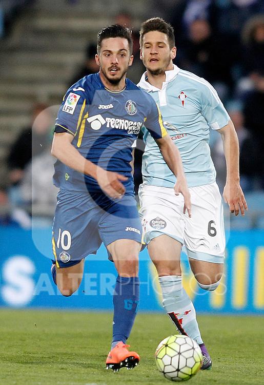 Getafe's Pablo Sarabia (l) and Celta de Vigo's Nemanja Radoja during La Liga match. February 27,2016. (ALTERPHOTOS/Acero)