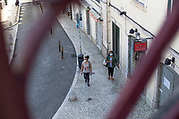 LISBON, PORTUGAL - MAY 18 :  People using protective facemasks are seen walking by a opened restaurant  in Lisbon, on May 18, 2020. <br /> Restaurants, museums and coffee shops reopen at reduced capacity, while Lisbon eases lockdown coronavirus disease (COVID-19) outbreak.<br /> (Photo by Luis Boza/VIEWpress via Getty Images)