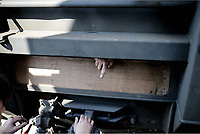 Pictured: The hand of a migrant man who has slid himself in the under carriage of a train at the OSE freight depot in Thessaloniki, Greece. Wednesday 05 April 2017<br /> Re: A year after an agreement was signed between Greece and Turkey for the management of refugees. Migrants, mostly from Morocco, Algeria and Tunisia, have been living in disused train carriages at the Thessaloniki freight depot of OSE in northern Greece, the company managing the railways in the country. Some of the migrants climb onto moving trains, or even hide themselves in storage areas, hoping that they will cross the border.