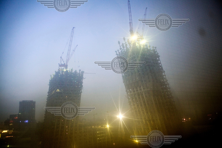 The new 550,000 square metre headquarters of China Central Television (CCTV). The building, designed by Rem Koolhaas, will be among the first of 300 new towers to be constructed in Beijing's new central business district (CBD).