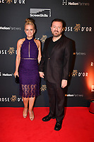 Picture by Simon Wilkinson/SWpix.com - 1/12/19 - Rose d'Or 2019 - Kings Place, London - Ricky Gervais, recipient of the Performance of the Year Award. On the red carpet with partner, Jane Fallon.