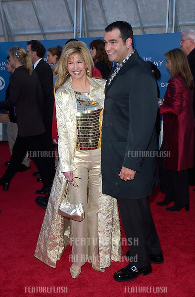 TV presenter LEEZA GIBBONS & husband at the 43rd Annual Grammy Awards in Los Angeles. .21FEB2001.  © Paul Smith/Featureflash