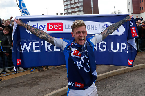 1st May 2021; Weston Homes Stadium, Peterborough, Cambridgeshire, England; English Football League One Football, Peterborough United versus Lincoln City; Sammie Szmodics of Peterborough United celebrates with fans outside The Weston Homes Stadium after winning promotion to the EFL Championship