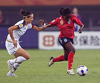 Kate Markgraf, Eniola Aluko. The USA defeated England, 3-0 during the quarterfinals of the FIFA Women's World Cup in Tianjin, China.  The USA defeated England, 3-0.
