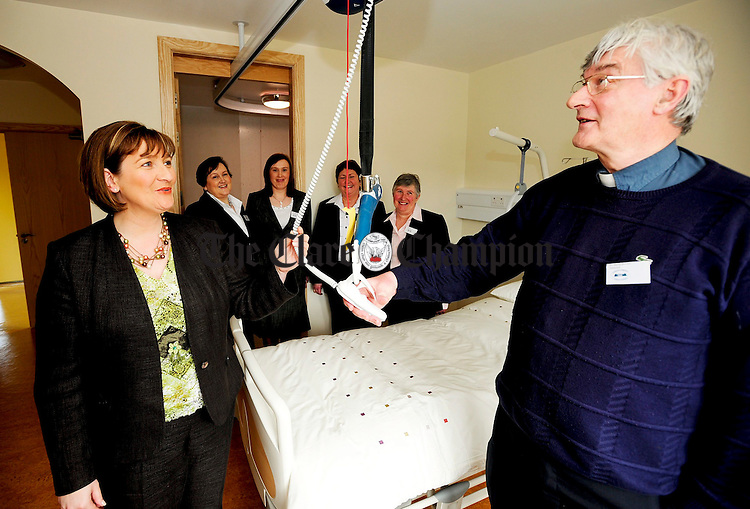 Minister of State at the Department of Health and Children Ms. Maire Hoctor TD gets a tour from Fr Harry Bohan during the official opening of a new extension to Cahercalla.Pic Arthur Ellis.