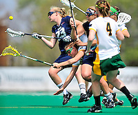 1 May 2010: University of Vermont Catamount midfielder Alison Haigh, a Senior from Northborough, MA, tumbles forward while attempting to gain ball possession during a game against the University of New Hampshire Wildcats at Moulton Winder Field in Burlington, Vermont. The Lady Catamounts fell to the visiting Wildcats 18-10 in the last game of the 2010 regular season. Mandatory Photo Credit: Ed Wolfstein Photo