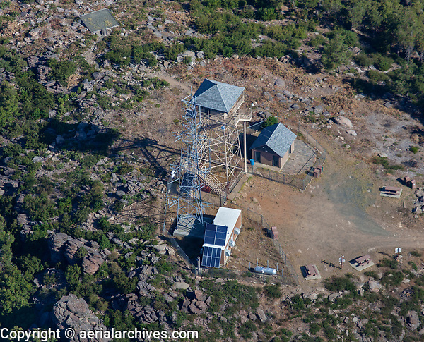 aerial photograph  of the Mount Konocti fire lookout tower, Lake County, California.  The tower owned by CalFire is 45' tall and is located at an elevation of 4299'.  It is staffed by volunteers.