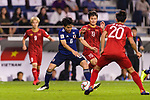 Endo Wataru of Japan (L) fights for the ball with Nguyen Quang Hai of Vietnam (R) during the AFC Asian Cup UAE 2019 Quarter Finals match between Vietnam (VIE) and Japan (JPN) at Al Maktoum Stadium on 24 January 2018 in Dubai, United Arab Emirates. Photo by Marcio Rodrigo Machado / Power Sport Images