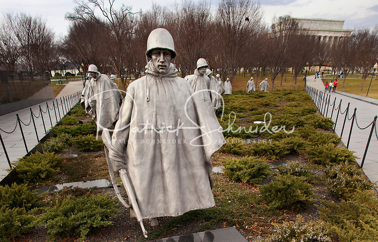 "The Korean War Veterans memorial in Washington, DC. General Douglas MacArthur said, ""Old soldiers never die, they just fade away."" When the last veteran of the Korean War fades into history, he can do so knowing that a memorial will remind future generations of his/her sacrifices in defense of South Korea. The statues depicting fighting men on patrol represent the army, navy, Marine Corps, and air force working together for a common goal - victory. A granite mural of over two thousand sandblasted photographs honors the supporting services who provided supply, medical, spiritual, and fire support to the frontline units."