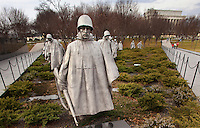 """The Korean War Veterans memorial in Washington, DC. General Douglas MacArthur said, """"Old soldiers never die, they just fade away."""" When the last veteran of the Korean War fades into history, he can do so knowing that a memorial will remind future generations of his/her sacrifices in defense of South Korea. The statues depicting fighting men on patrol represent the army, navy, Marine Corps, and air force working together for a common goal - victory. A granite mural of over two thousand sandblasted photographs honors the supporting services who provided supply, medical, spiritual, and fire support to the frontline units."""