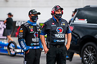 Jul 11, 2020; Clermont, Indiana, USA; NHRA top fuel driver Antron Brown with crew chief during qualifying for the E3 Spark Plugs Nationals at Lucas Oil Raceway. This is the first race back for NHRA since the start of the COVID-19 global pandemic. Mandatory Credit: Mark J. Rebilas-USA TODAY Sports