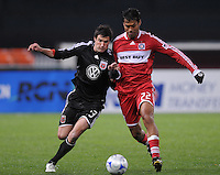 DC United midfielder Chris Pontius (13) fights to control the ball against Chicago fire defender Wilman Conde (22). Chicago Fire tied DC United 1-1 at  RFK Stadium, Saturday March 28, 2009.