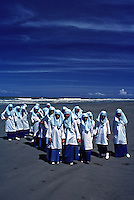 Images from the Book Journey Through Colour and Time. Like a flock of seagulls on the Beach these Brunei Muslim school children enjoying a day out on the beach.