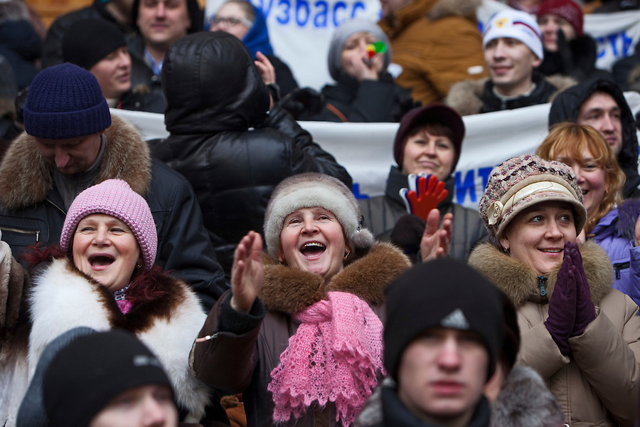 Moscow, Russia, 23/02/2003..Women cheer during a rally at Luzhniki sports stadium supporting Prime Minister Vladimir Putin's presidential election campaign.