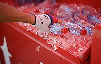 as the heat wave continues to hot the Tour, ice-water is eagerly obtained by the riders from the Tour's sponsor at the start<br /> <br /> stage 16: Bourg de Péage - Gap (201km)<br /> 2015 Tour de France