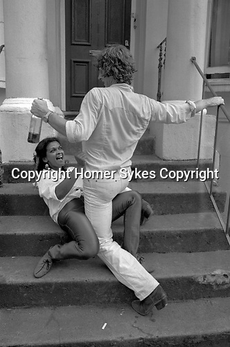 Couple dancing, both are drunk  1981 during the Notting Hill Carnival.