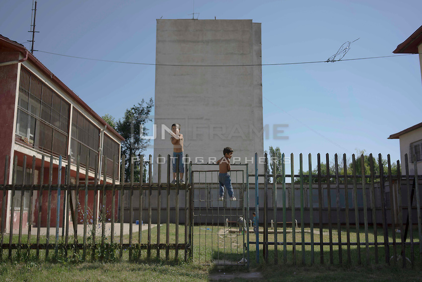 Lunik IX is now home to five thousand Roma, since 2011 the local government have demolished five blocks subsequently living Roma inhabitant now where to live. Roma children playing trying to climb the fence into the kindergarten school.