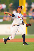 Shortstop Edward Salcedo #15 of the Rome Braves makes a throw to home plate against the Greenville Drive at State Mutual Stadium July 24, 2010, in Rome, Georgia.  Photo by Brian Westerholt / Four Seam Images