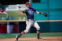 Frisco RoughRiders Charles Leblanc (12) throws to first base during a Texas League game against the Amarillo Sod Poodles on May 19, 2019 at Dr Pepper Ballpark in Frisco, Texas.  (Mike Augustin/Four Seam Images)
