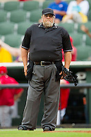 Home plate umpire Mike Watkins between innings of the South Atlantic League game between the Lakewood BlueClaws and the Kannapolis Intimidators at Fieldcrest Cannon Stadium on July 16, 2011 in Kannapolis, North Carolina.  The Intimidators defeated the BlueClaws 5-3.   (Brian Westerholt / Four Seam Images)