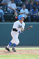 Kevin Kramer (7) of the UCLA Bruins bats during a game against the Arizona Wildcats at Jackie Robinson Stadium on May 16, 2015 in Los Angeles, California. UCLA defeated Arizona, 6-0. (Larry Goren/Four Seam Images)