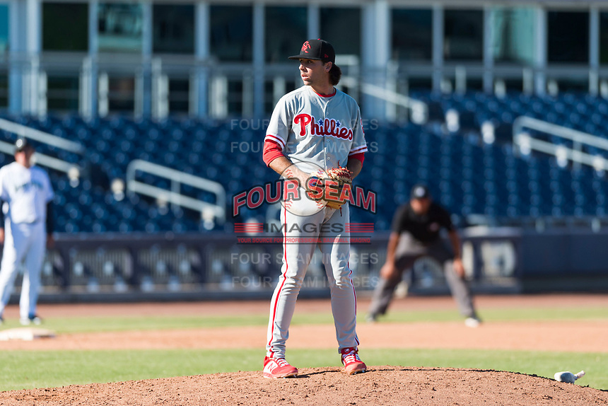 Scottsdale Scorpions relief pitcher Jonathan Hennigan (2), of the Philadelphia Phillies organization, gets ready to deliver a pitch during an Arizona Fall League game against the Peoria Javelinas at Peoria Sports Complex on October 18, 2018 in Peoria, Arizona. Scottsdale defeated Peoria 8-0. (Zachary Lucy/Four Seam Images)