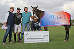 WELLINGTON, FL - APRIL 15:  Mini Watt is awarded the Best Play Pony in final of the $100,000 World Cup tournament by the American Polo Horse Association (APHA) for Santi Torres at the Grand Champions Polo Club, on April 15, 2017 in Wellington, Florida. (Photo by Liz Lamont/Eclipse Sportswire/Getty Images)