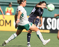 Homare Sawa #10 of the Washington Freedom shoots the ball past Lisa Stoia #7 of St. Louis Athletica during a WPS match at RFK Stadium on July 18 2009, in Washington D.C. Freedom won the match 1-0.