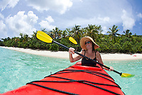 Kayaker paddling along the shore<br /> Honeymoon Beach<br /> Virgin Islands National Park<br /> St. John, U.S. Virgin Islands